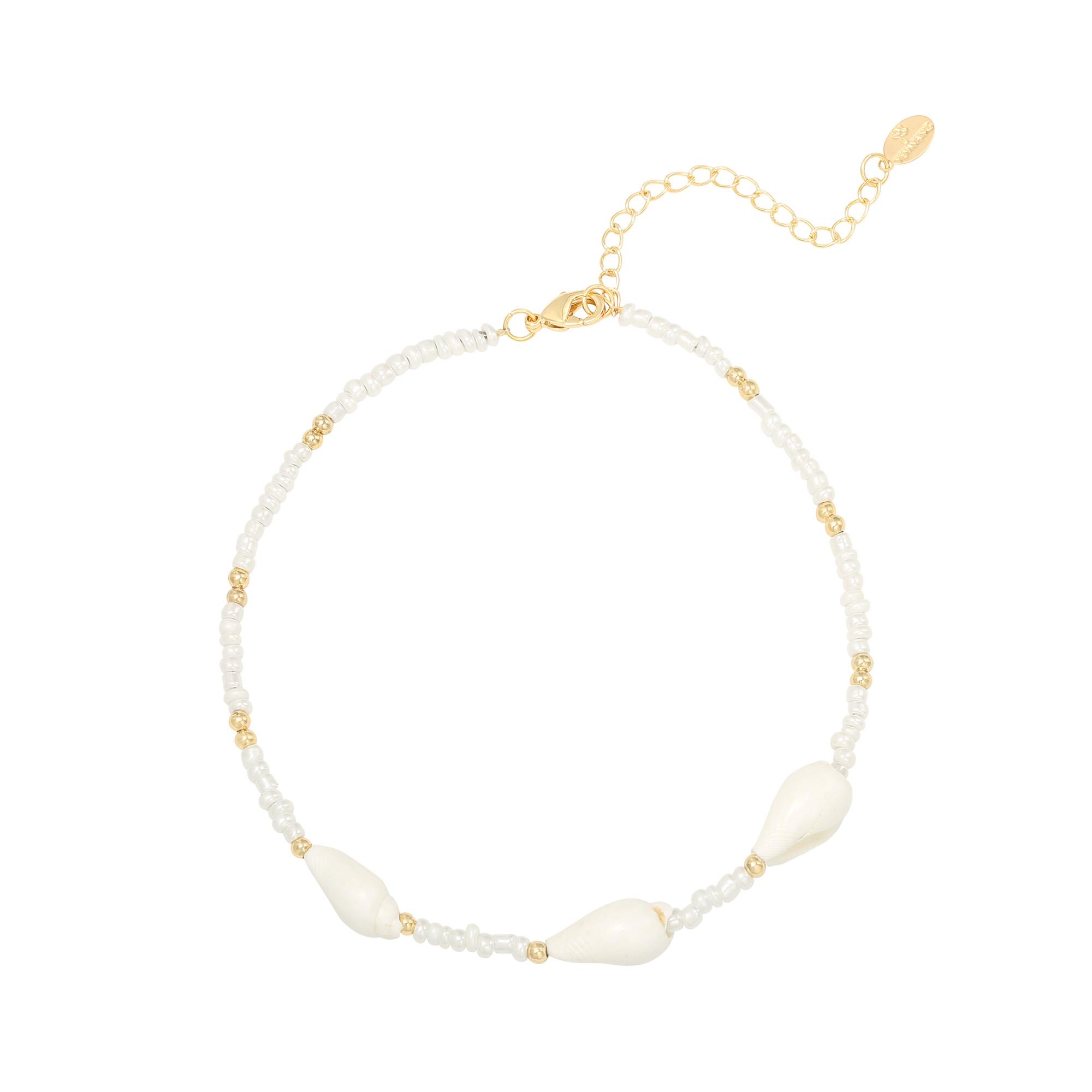 Bandajanas enkelband Hoornschelpjes is een heerlijkzomers enkelbandje in de kleuren wit/goud. Staat prachtig bij jouw bruine benen!